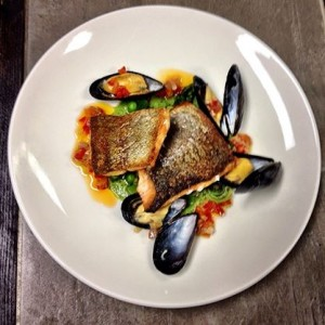 Pan Roasted Rainbow Trout with Spring Giardiniera, Fiddleheads, PEI Mussels, and Prosciutto Soffritto